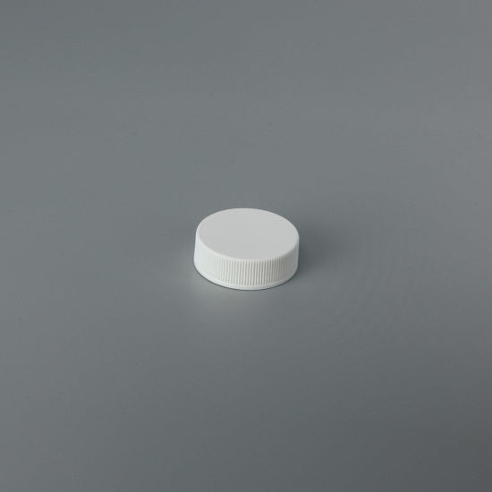 Picture of 33-400 White PP Ribbed Sides Cap with FS3-19.020 Plain Liner (Heat Seal For PET/PVC)